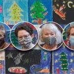 Weihnachtliche Bilder hängen in der Kinderbibliothek aus
